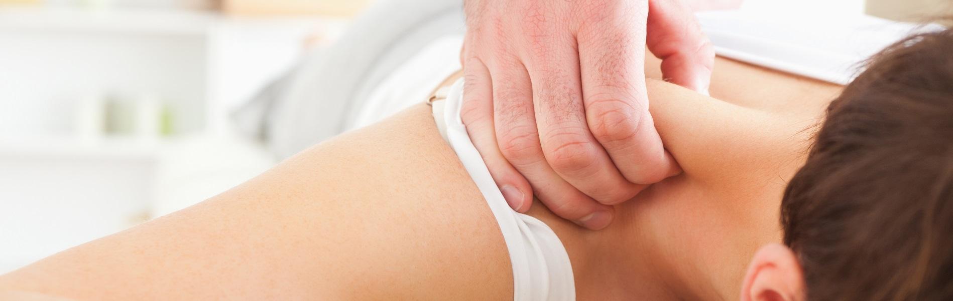 Brunette Woman getting a neck-massage